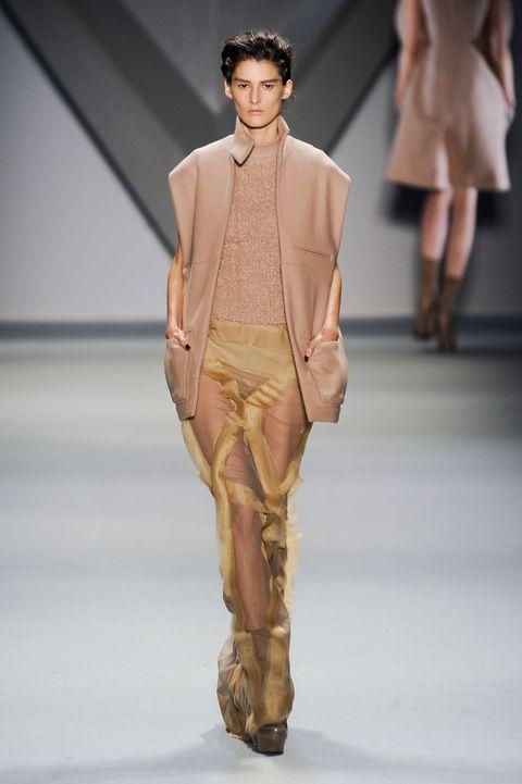 Human, Leg, Fashion show, Brown, Human body, Skin, Shoulder, Runway, Joint, Outerwear,