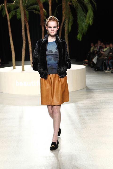 Clothing, Brown, Shoulder, Outerwear, Human leg, Jacket, Fashion show, Style, Fashion accessory, Bag,