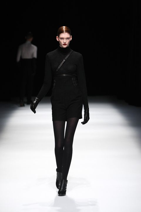 Clothing, Fashion show, Sleeve, Shoulder, Joint, Outerwear, Standing, Runway, Fashion model, Winter,