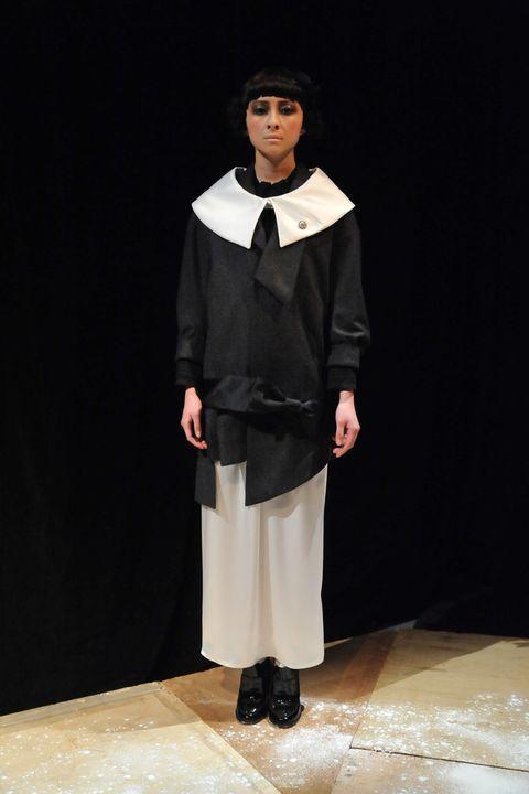 Sleeve, Collar, Formal wear, Costume design, Fashion, Uniform, Drama, Acting, Fashion design, Costume,