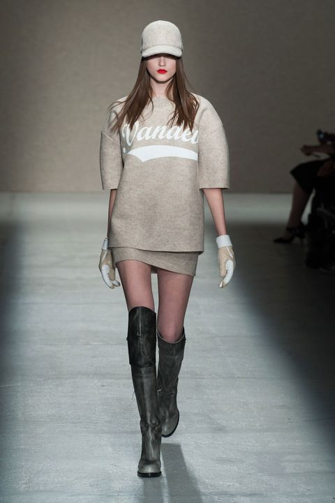Clothing, Shoulder, Human leg, Fashion show, Joint, Outerwear, Style, Knee, Fashion model, Runway,