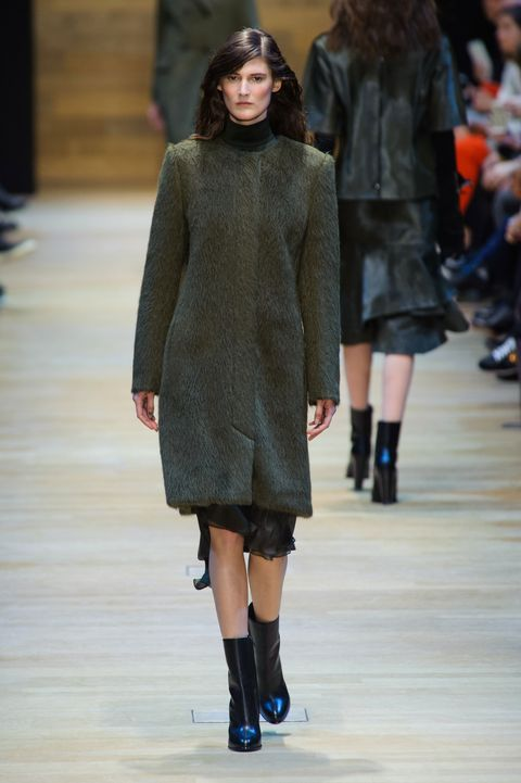 Clothing, Footwear, Fashion show, Sleeve, Event, Shoulder, Joint, Outerwear, Runway, Human leg,