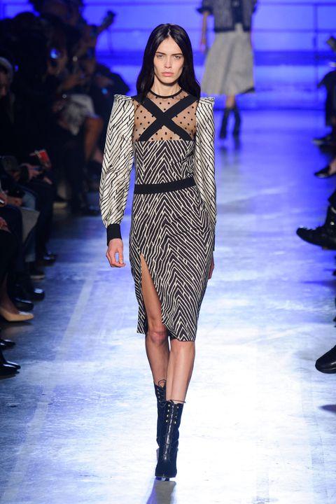 Clothing, Footwear, Fashion show, Blue, Event, Runway, Shoulder, Human leg, Joint, Fashion model,