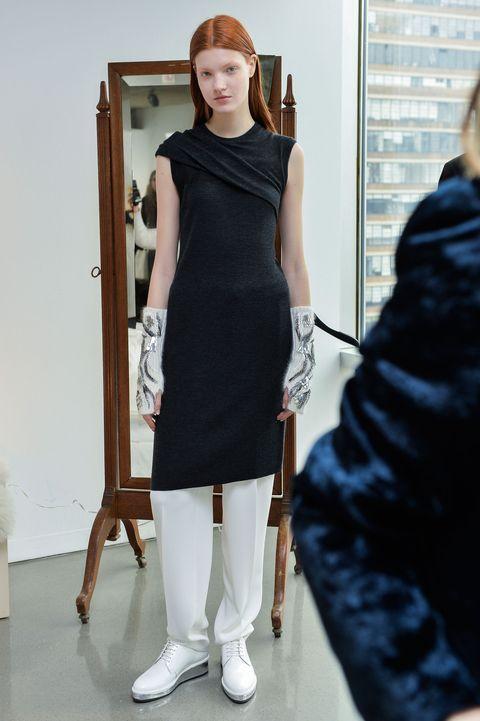 Shoulder, Joint, Standing, Dress, Waist, One-piece garment, Fashion, Door, Day dress, Trunk,