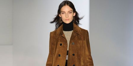 Clothing, Brown, Sleeve, Fashion show, Shoulder, Textile, Joint, Human leg, Outerwear, Coat,