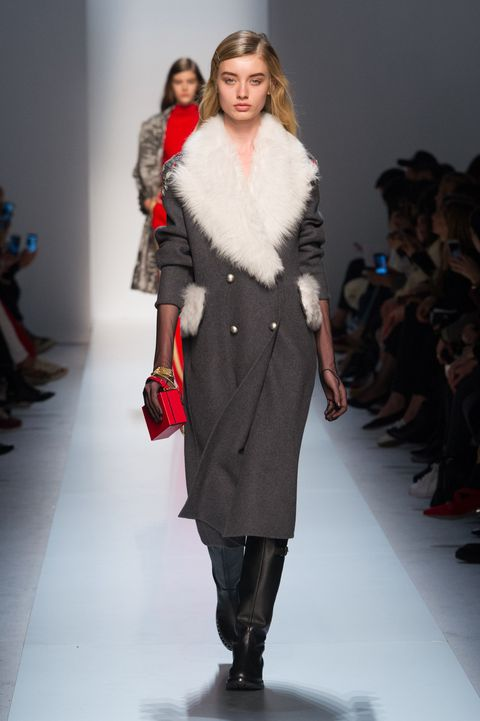 Event, Fashion show, Shoulder, Runway, Joint, Outerwear, Fashion model, Style, Winter, Knee,