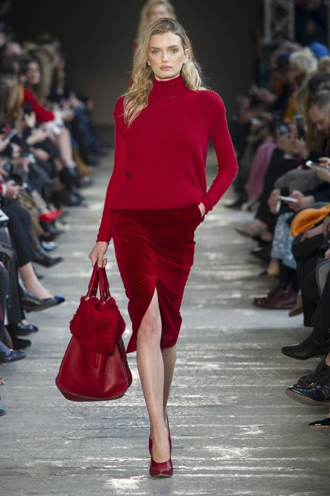 Clothing, Footwear, Event, Shoulder, Red, Human leg, Fashion show, Joint, Outerwear, Style,