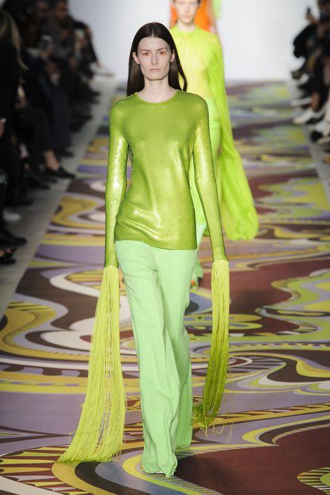 Nose, Human, Yellow, Green, Textile, Fashion show, Style, Fashion model, Runway, Waist,