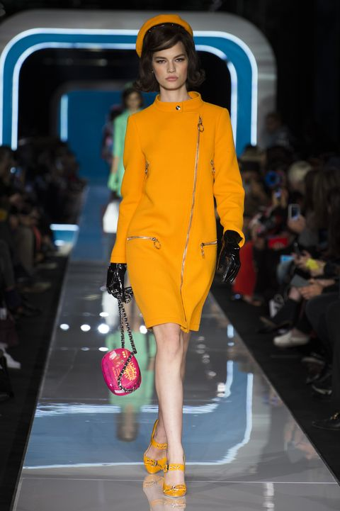 Yellow, Shoulder, Fashion show, Human leg, Joint, Outerwear, Runway, Style, Dress, Street fashion,