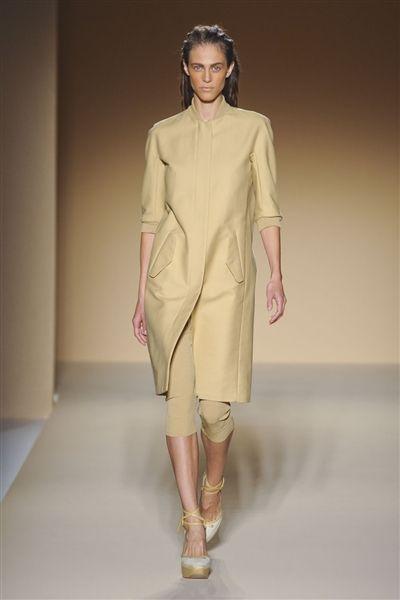 Clothing, Sleeve, Shoulder, Fashion show, Joint, Human leg, Runway, Style, Fashion model, Dress,