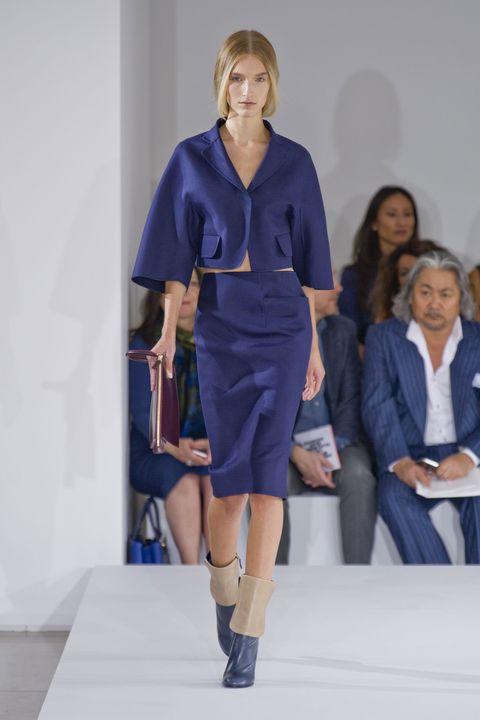 Sleeve, Shoulder, Human leg, Joint, Outerwear, Fashion show, Style, Knee, Fashion model, Electric blue,