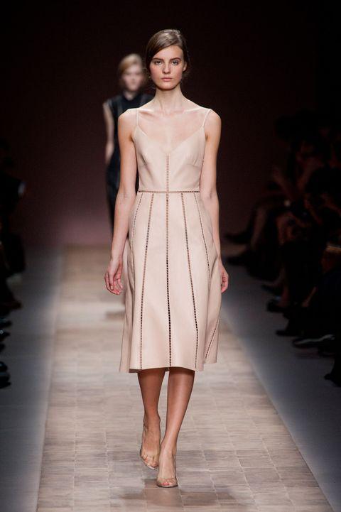 Brown, Fashion show, Shoulder, Runway, Joint, Human leg, Dress, One-piece garment, Fashion model, Waist,