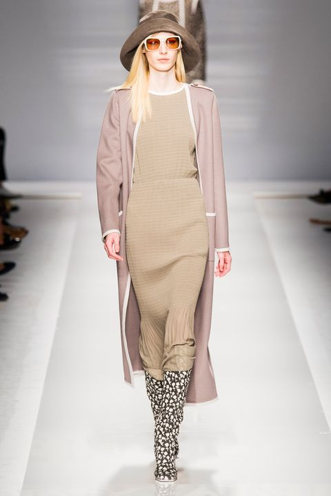 Clothing, Brown, Sleeve, Fashion show, Shoulder, Joint, Outerwear, Fashion model, Style, Runway,