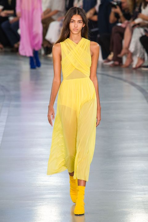 Clothing, Fashion show, Yellow, Event, Runway, Shoulder, Joint, Human leg, Fashion model, Waist,