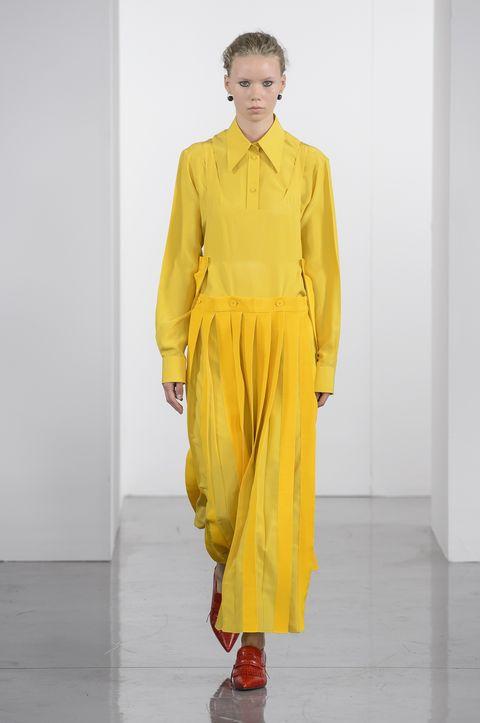 Fashion model, Clothing, Fashion, Runway, Yellow, Fashion show, Orange, Shoulder, Neck, Joint,