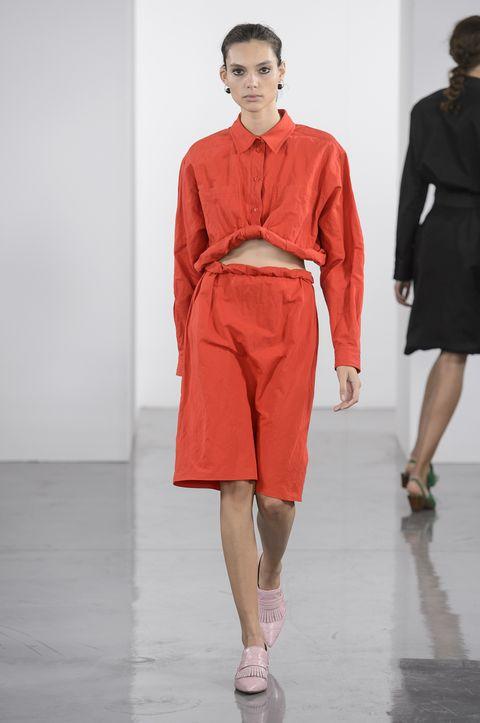 Fashion model, Fashion show, Runway, Fashion, Clothing, Orange, Red, Shoulder, Public event, Event,