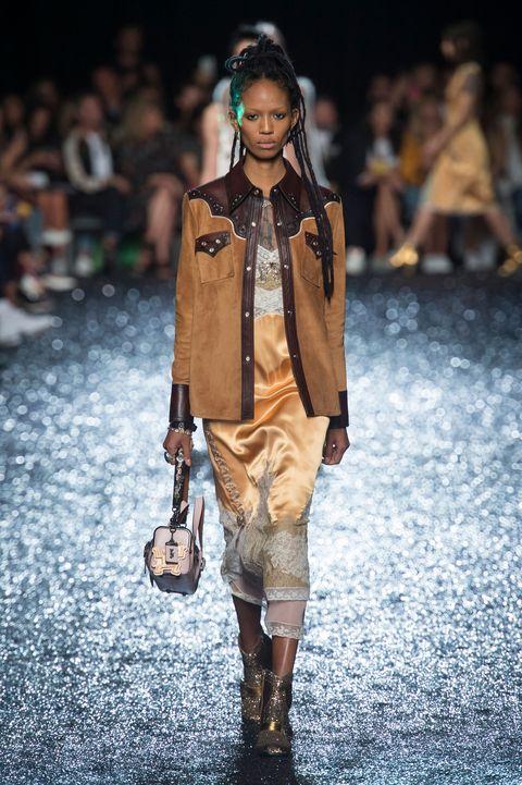 Fashion model, Fashion show, Runway, Fashion, Street fashion, Human, Outerwear, Shoulder, Footwear, Fashion design,