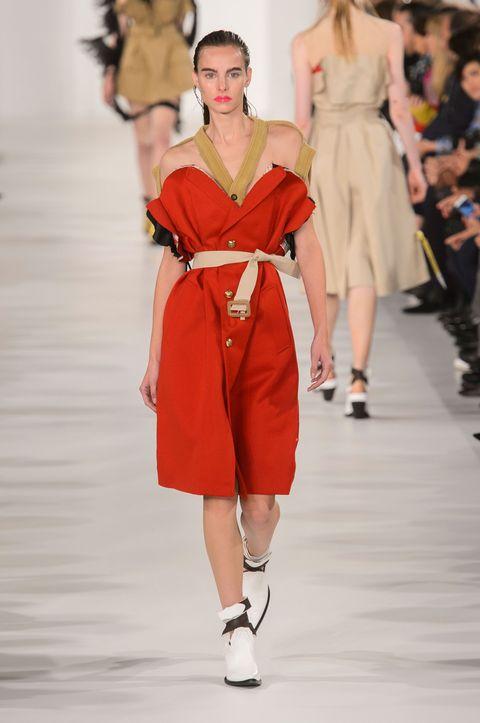 Fashion model, Fashion, Fashion show, Runway, Clothing, Shoulder, Dress, Joint, Footwear, Haute couture,