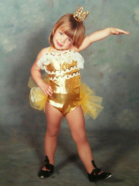 Clothing, Yellow, Leg, Thigh, Costume, Footwear, Child model, Human leg, Child, Smile,