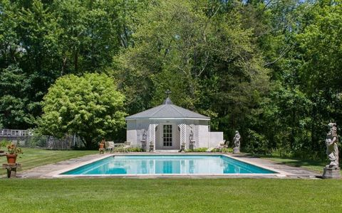 Grass, Property, Swimming pool, Real estate, Garden, Aqua, Lawn, Turquoise, Shrub, Park,