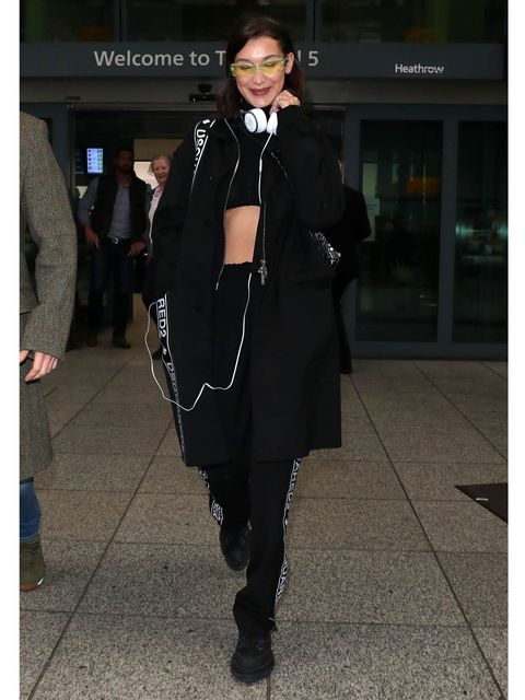Trousers, Outerwear, Standing, Bag, Style, Coat, Street fashion, Luggage and bags, Fashion, Scarf,
