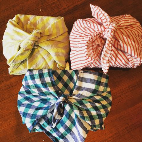 Ribbon, Pattern, Hardwood, Present, Paper product, Knot, Gift wrapping, Paper, Wood stain, Wood flooring,