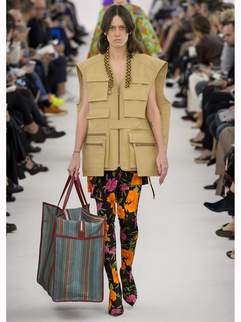 Clothing, Footwear, Fashion show, Textile, Joint, Bag, Outerwear, Style, Runway, Pattern,