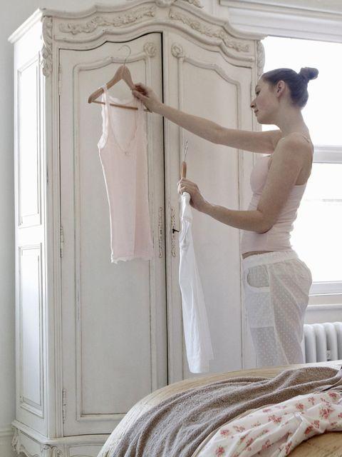White, Furniture, Room, Bed, Clothes hanger, Bedroom, Wardrobe, Linens, Interior design, Bed sheet,