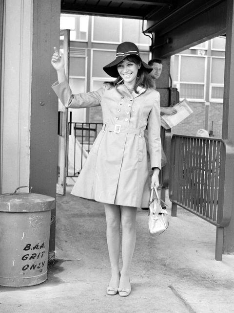 Clothing, Sleeve, Hat, Shoe, Photograph, Standing, Coat, Monochrome, Style, Fashion accessory,