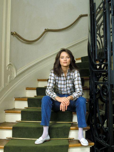 stairs, denim, jeans, human leg, sitting, knee, street fashion, long hair, outdoor shoe, handrail,