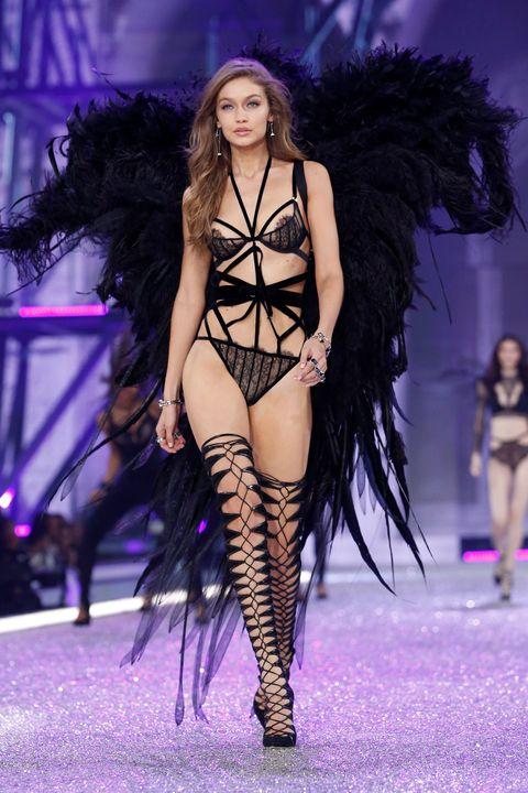 Head, Human, Leg, Mouth, Hairstyle, Human body, Fashion show, Purple, Runway, Fashion model,