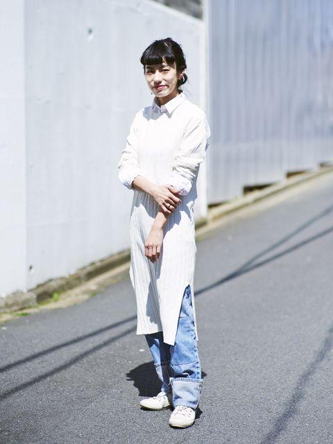 Clothing, Blue, Sleeve, Textile, Standing, Denim, Asphalt, Style, Street fashion, Collar,