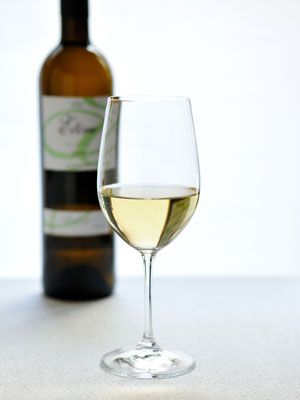 Fluid, Liquid, Drinkware, Glass, Yellow, Drink, Stemware, Bottle, Wine glass, Alcohol,