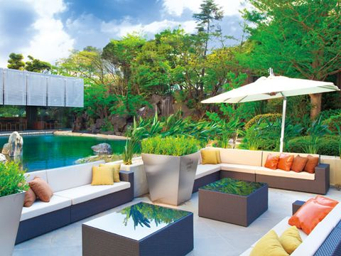 Couch, Resort, Outdoor furniture, Outdoor sofa, Swimming pool, studio couch, Shade, Garden, Landscaping, Patio,