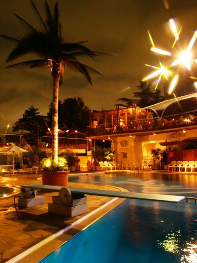 Swimming pool, Resort, Arecales, Reflection, Midnight, Water feature, Resort town, Hotel, Palm tree, Fireworks,