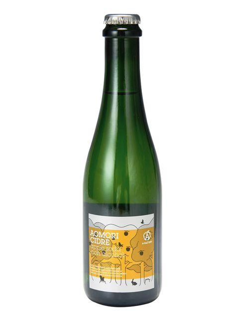 Product, Yellow, Bottle, Glass bottle, Drink, Logo, Black, Alcoholic beverage, Wine bottle, Label,
