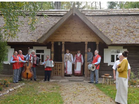 Drum, Social group, House, Musical instrument, Roof, Musical ensemble, Membranophone, Door, Cottage, Lawn,
