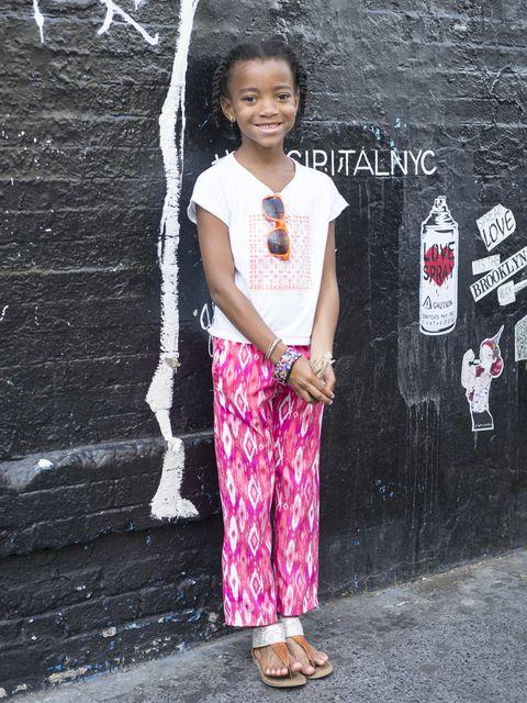 Standing, Pink, Magenta, Street fashion, Baby & toddler clothing, Sandal, Drink, Slipper, Foot, Pattern,