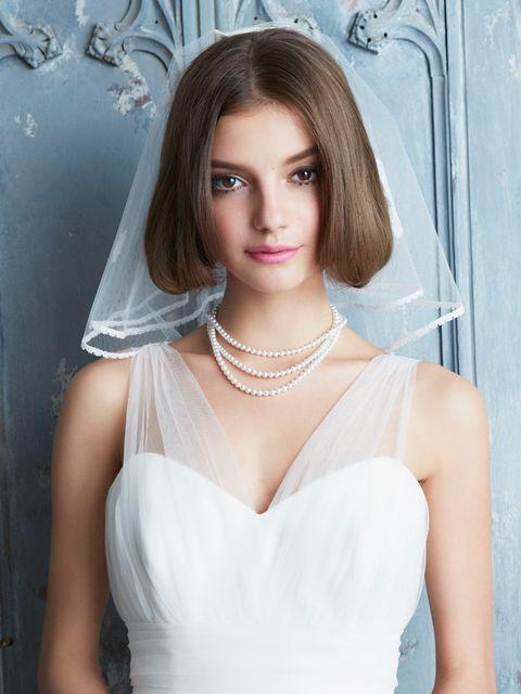 Clothing, Hairstyle, Skin, Shoulder, Photograph, Joint, White, Bridal accessory, Bridal clothing, Eyelash,