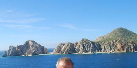 Coastal and oceanic landforms, Water, Tourism, Promontory, Boat, Ocean, Sea, Rock, Travel, Azure,