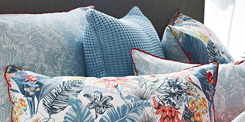 Blue, Orange, Textile, Cushion, Pattern, Throw pillow, Linens, Pillow, Bedding, Home accessories,
