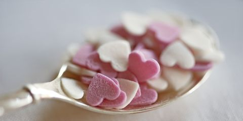 Pink, Petal, Sweetness, Hair accessory, Heart, Artificial flower, Natural material, Sugar paste, Confectionery,