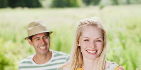 Face, Mouth, Smile, Hat, Happy, Flower, People in nature, Facial expression, Summer, Petal,