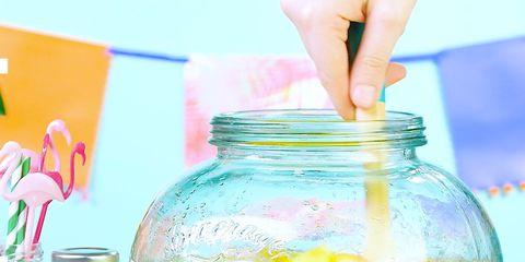 Mason jar, Yellow, Product, Drink, Water bottle, Tableware, Glass, Lemonade, Juice, Drinkware,
