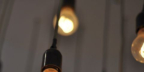 Lighting, Ceiling fixture, Light fixture, Electricity, Lighting accessory, Ceiling, Interior design, Amber, Tints and shades, Light,