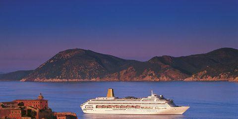 Body of water, Watercraft, Water, Cruise ship, Coastal and oceanic landforms, Passenger ship, Waterway, Boat, Ocean liner, Hill,