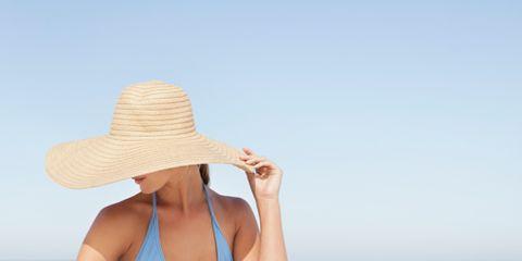 Skin, Hat, Shoulder, Human leg, Brassiere, Joint, Elbow, Summer, Swimwear, Undergarment,