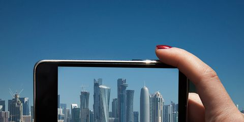 Finger, Tower block, City, Technology, Metropolitan area, Thumb, Urban area, Commercial building, Display device, Azure,