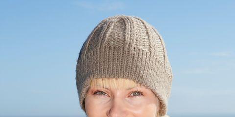 Lip, Smile, Winter, Skin, Textile, Photograph, Wool, Ocean, Fashion accessory, Beauty,