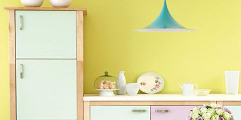 Room, Yellow, Furniture, Table, Floor, Interior design, Cabinetry, Party hat, Chair, Turquoise,